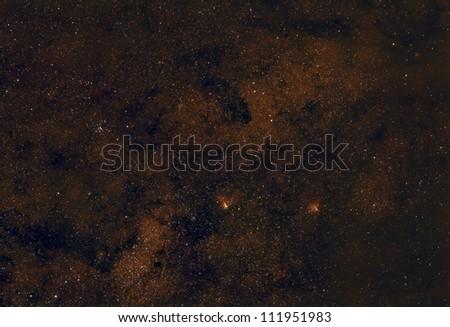Omega Nebula, Eagle Nebula and the M25 Star Cluster - stock photo