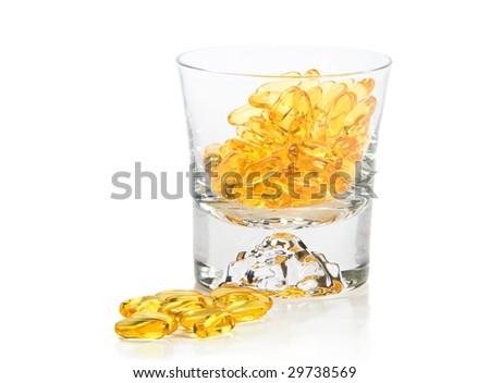 Omega-3 vitamins in glass  on white background - stock photo