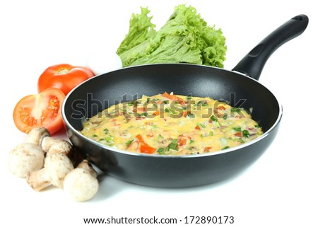 Omelet with vegetables isolated on white - stock photo