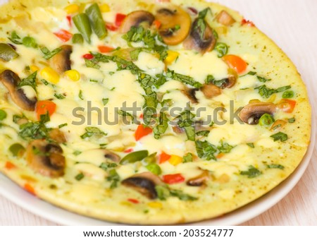 omelette with mushrooms and vegetables - stock photo