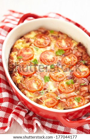 Omelette with tomato and sausage - stock photo