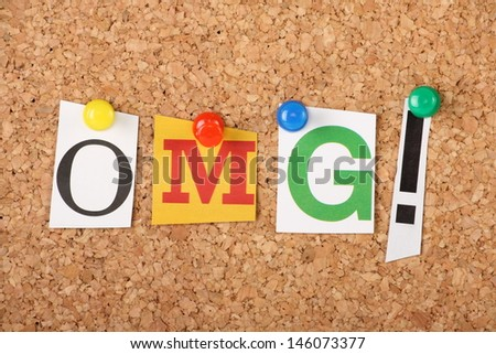 OMG the well known expression or abbreviation for Oh My God with an exclamation mark in cut out magazine letters pinned to a cork notice board - stock photo
