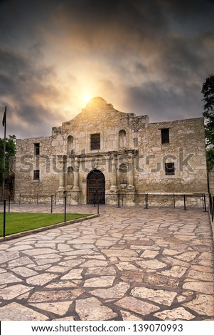 Ominous sky hovering over the historic Alamo in San Antonio, TX - stock photo
