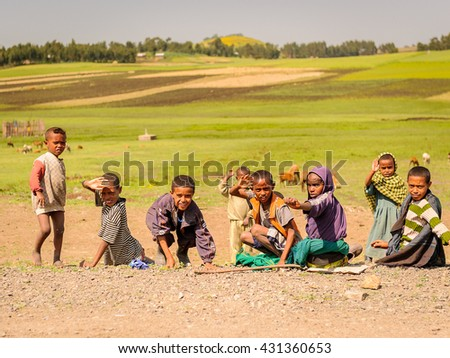 OMO, ETHIOPIA - SEPTEMBER 21, 2011: Unidentified Ethiopian children in the field. People in Ethiopia suffer of poverty due to the unstable situation - stock photo