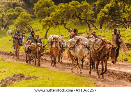 OMO, ETHIOPIA - SEPTEMBER 21, 2011: Unidentified Ethiopian men and horses. People in Ethiopia suffer of poverty due to the unstable situation - stock photo