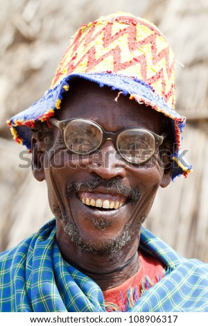 OMO VALLEY, ETHIOPIA - AUG 16: Elder Dasanech ethnicity smiling,the ethnic groups in the Omo valley Could disappear Because of Gibe III hydroelectric dam on Aug 16, 2011 in Omo Valley, Ethiopia. - stock photo