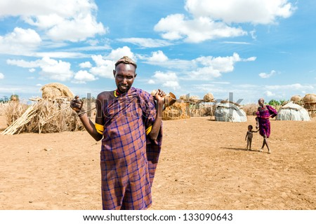 OMO VALLEY, ETHIOPIA - AUG 15: Erbore man posing in the village,the ethnic groups in the The Omo valley Could disappear Because of Gibe III hydroelectric dam. on Aug 15, 2011 in Omo Valley, Ethiopia. - stock photo
