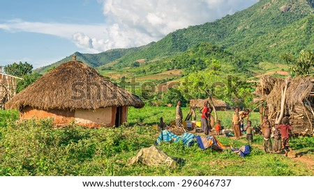 OMO VALLEY, ETHIOPIA - MAY 6, 2015 : Ethiopian family preparing dinner in front of their home in the southern part of Ethiopia. - stock photo