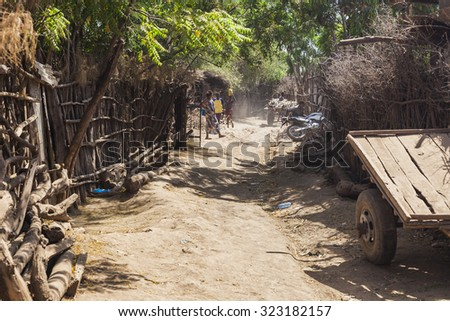 OMORATO, LOWER OMO VALLEY, ETHIOPIA - JANUARY 31, 2012: Street in traditional village of Dassanech tribe.  Omorato one of the poorest places in Ethiopia. - stock photo