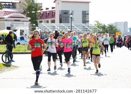 OMSK, RUSSIA - MAY 24 : A group of woman marathon runners compete at the Siberian Spring Half Marathon 2015 in Omsk, Russia, May 24,  2015. - stock photo