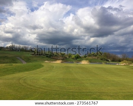 On a empty golf course before heavy storm - stock photo