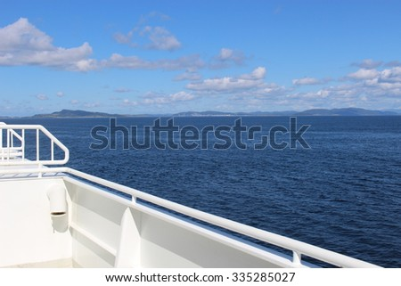 On a ferry in Norway, Europe. The ship is passing the Fjord Boknafjorden. - stock photo