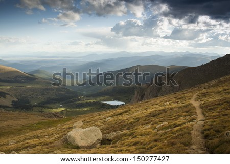 On a hazy summer Evening at 13,000 feet you can see forever--almost to the prairies of Kansas from here. Mount Evans Wilderness, Front Range, Colorado. - stock photo