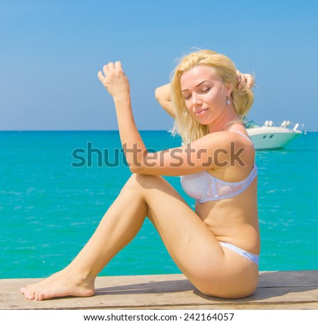 On a Jetty Gorgeous Woman  - stock photo