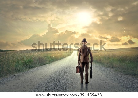 On a long road in the countryside - stock photo