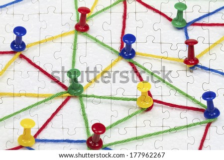 On a puzzle, a network is depicted. - stock photo