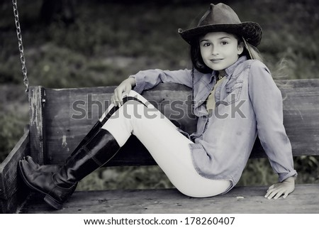 On a ranch - portrait of lovely cowgirl - stock photo