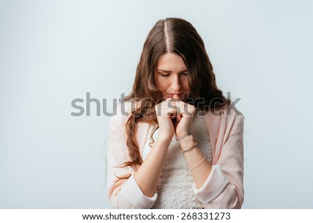 on a white background young girl prays - stock photo