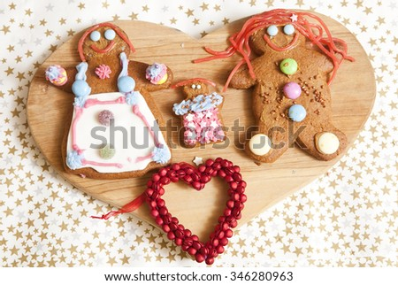 On Display. An afternoon of baking and decorating has created this family of gingerbread people. They are all ready to wrapped in cellophane and given for Christmas. - stock photo