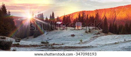 On high alpine pastures of the Carpathians golden autumn arrives with its first snow covering the construction Ukrainian shepherd. This is their church, working in summer for the Hutsul mountaineers - stock photo