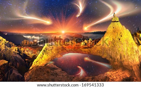 On lights background dawn mist above the waves, in the Carpathian Mountains towering Alpine peaks lonely mountain-Khomyak  It is a beautiful rock with a small lake of clear water reflecting the sky .. - stock photo