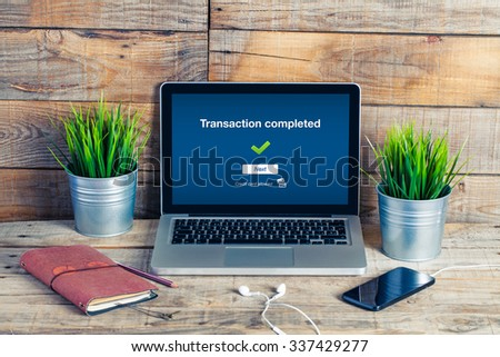 On line banking on computer. Transaction completed text in the screen. - stock photo