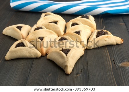 On Purim, Ashkenazi Jews eat triangular pastries called Hamantaschen (Haman's pockets) or Oznei Haman (Haman's ears) - stock photo