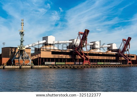 On-shore coal cargo terminal with heavy duty conveyor and lifting crane - stock photo