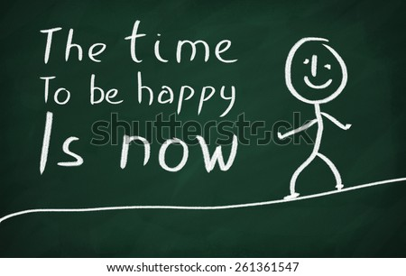 On the blackboard draw character and write The time to be happy is now - stock photo