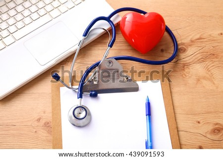 on the desktop, notebook paper and stethoscope glasses - stock photo