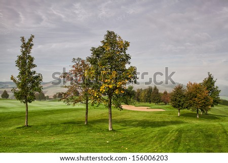 On the empty golf course very early morning - stock photo