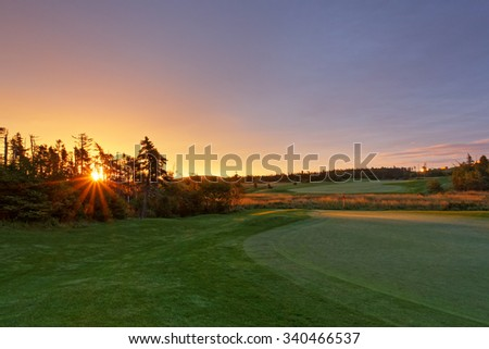 On the golf course at sunrise. - stock photo