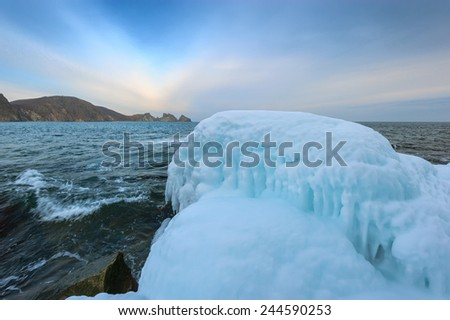On the shores of the winter sea. East Sea. - stock photo