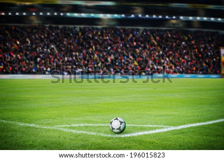 On the stadium. Soccer field with soccer ball and line - stock photo