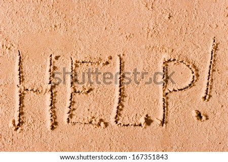 "on the wet sand written the word ""Help!"" by the sea - stock photo"