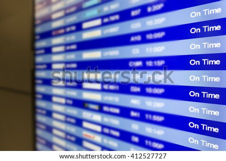On Time board listing arrivals and departures. Airport schedule  - stock photo