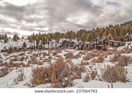 Once a thriving mining town in Montana, this is what remains of people's homes and business. - stock photo