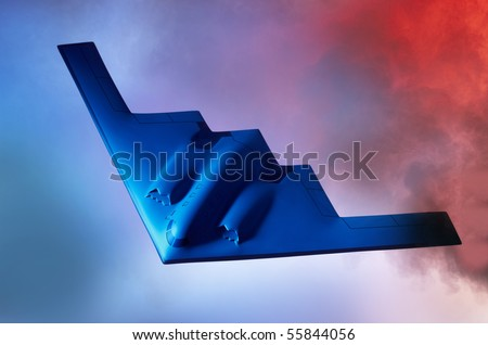 Oncoming Stealth B-2 Bomber shot against a blue orange sky with room for copy - stock photo