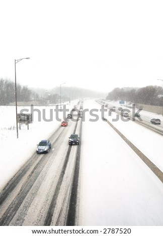 Oncoming traffic in a snowstorm - stock photo