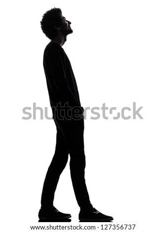 one african handsome young man standing  looking up smiling  in silhouette studio isolated on white background - stock photo