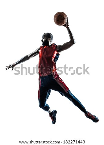 one african man basketball player jumping dunking in silhouette isolated white background - stock photo