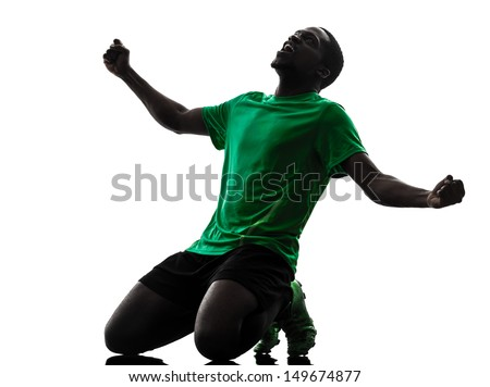 one african man soccer player celebrating victory green jersey in silhouette  on white background - stock photo