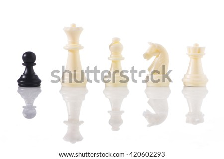 One against all - a black pawn with white chess pieces - stock photo