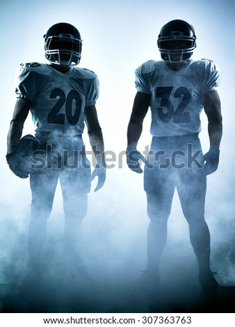 one american football players portrait in silhouette shadow on white background - stock photo