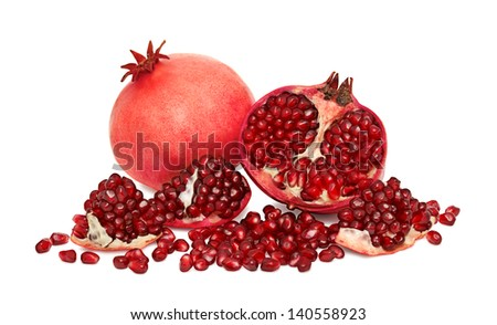One and a half pomegranate with seeds isolated on white background - stock photo