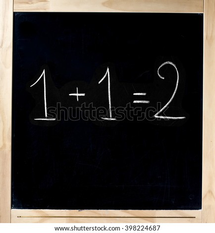One and One is Two equation handwritten on blackboard isolated - stock photo
