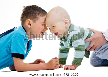 One and seven years old brothers laughing - stock photo