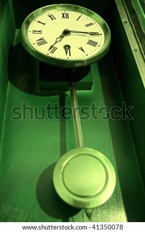 One antique old retro pendulum clock - stock photo