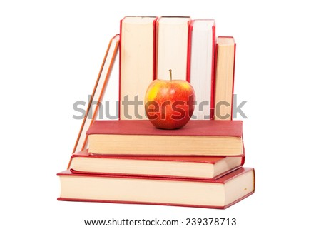One Aplle is Laying on a staple of Red Books. Isolated on White. - stock photo