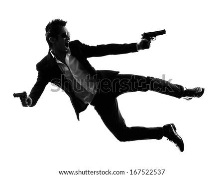 one asian gunman killer jumping shooting  in silhouette isolated white background - stock photo